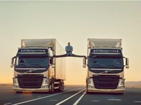 Jean Claude Van Damme Does The Splits Between Two Moving Volvo Truck