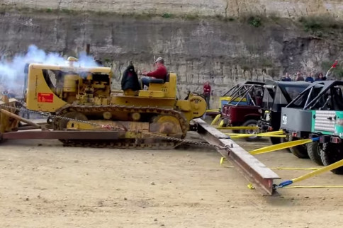 Video: One Diesel Caterpillar vs. Twenty Toyotas. Any Bets?